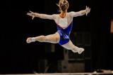 floor exercise split jump female gymnast at gymnastics championship - 228333586
