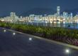 Promenade and Skyline of  harbor in Hong Kong city at night