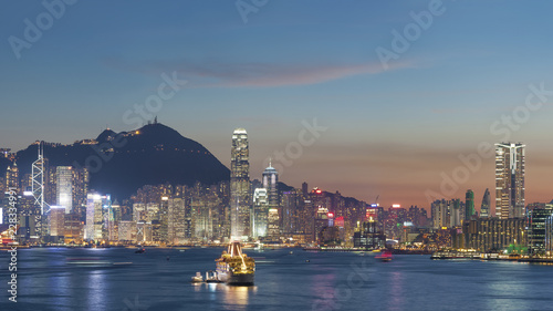 Wall mural Panorama of Victoria Harbor of Hong Kong city at dusk