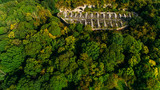 Aerial view of beautiful ancient fortress in forest in summer. Tarakaniv Fort. - 228340331