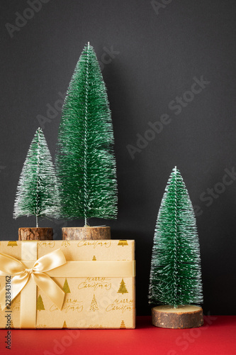 Foto Murales Christmas decoration green fir trees figure on red ground