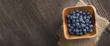 ripe sweet blueberries on wooden table