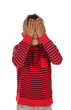 Small latin child covering their eyes