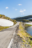Norwegian country road on the top of the fjord mountains - 228374519