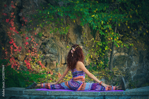 Obraz na płótnie young woman practice yoga spaga pose outdoor colorful autumn background