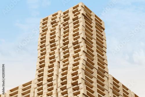 Europaletten Holzpaletten zu Türmen gestapelt - Aufnahme nach oben - Querformat - Hintergrund blauer Himmel © Lichtfexx