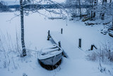 Frozen and covered by snow boat  - 228390129
