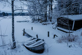 Frozen and covered by snow boat  - 228390159