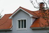 Classic traditional house in Scandinavia countryside, roof closeup. - 228396718