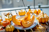 Pumpkins and leaves on a wooden table