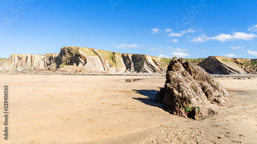 Cornwall Bude Beach with cliffs in the background - 228406563