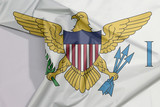 Virgin Islands fabric flag crepe and crease with white space, the coat of arms of the United States between the letters V and I. - 228417730