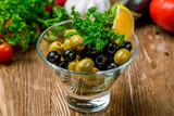 Kalamata olives on wooden table