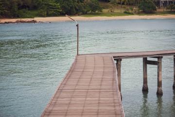 The wooden bridge in the sea