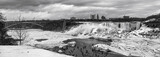 Black and white image dowriver of Niagara Falls frozen in winter