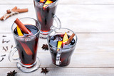 Mulled wine with cinnamon sticks and orange. Top view with copy space.