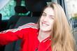 pretty blonde smiling driver girl in van car in summer