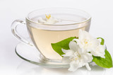 Glass cup of Tea with jasmine flowers and leaves - 228452596
