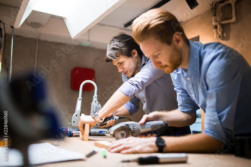 Business people collaborating in office and working on project together - 228460160