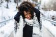 Quadro Young expressive black woman having fun in winter outdoor.
