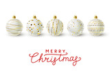 White Christmas balls with golden decorations