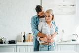 sensual boyfriend hugging girlfriend from back in kitchen - 228468396