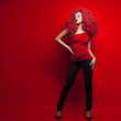 Leinwanddruck Bild - Portrait of beautiful young woman with red hair on red background