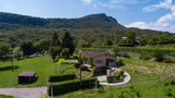 Aerial view of house with swimming pool in the countryside with hills - 228485167