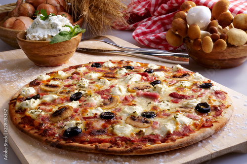 Pizza with ham, mushrooms and black olives - 228493157