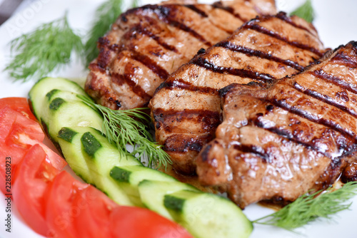 Grilled meat. Restaurant dish. Steak with vegetables. - 228508923