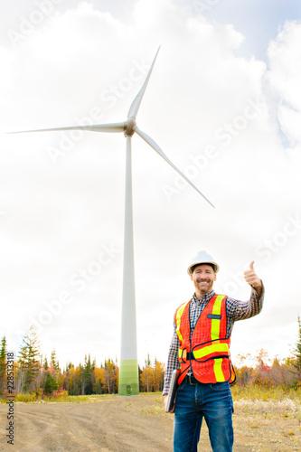 Leinwandbild Motiv A Technician Engineer in Wind Turbine Power Generator Station