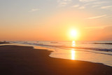 Beautiful sunrise over the ocean nature background.Southern marine landscape with sun rising over the atlantic ocean at the Huntington Beach State Park, Litchfield, Myrtle Beach area, South Carolina. - 228527536