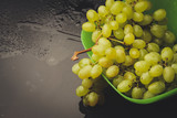 bunch of grapes in a plate on a dark background