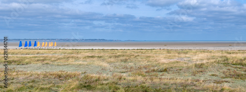 French landscape - Bretagne. Panorama of a beautiful beach with land yachts in the foreground - 228544701