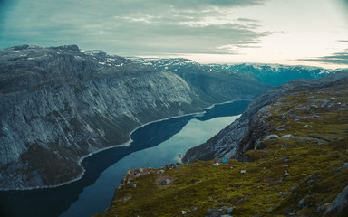Striking aerial panorama view of a scenic sunset. Norwegian fjord with a house, forest, at sunset. Norway Mountain Vibrant Landscape Trolltunga Odda Fjord Norge Hiking Trail © Pavel Kašák