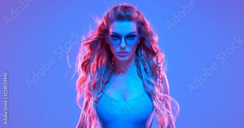Leinwanddruck Bild Warrior woman in Fashion neon light. Creative Art