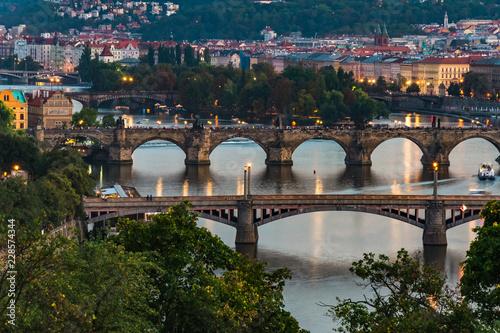 Fototapeta Sunset at Letna Park (Prague, Czech Republic). View of the bridges on the Moldava River