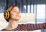 Young woman with headphones listening to music - 228610937