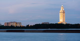 Night Falls While a Barge Travels Down Mississippi River Showing State Capital Building Baton Rouge - 228636113