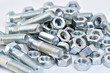 Fasteners on a white background. Manufacture of metal products.