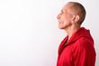 Close up profile view of bald senior man against white backgroun