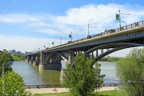 Fototapeta Automobile bridge over the Ob river on a summer day in Novosibirsk