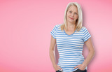 Happy woman in white shirt isolated on bright pink background - 228656159