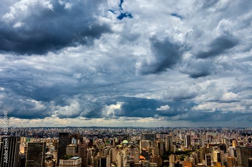 dramatic storm clouds over Sao Paulo skyline - 228658140