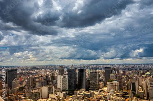 Fridge magnet dramatic storm clouds over Sao Paulo skyline