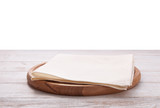 Pizza board, with napkin on wooden table isolated. Top view mockup - 228668520