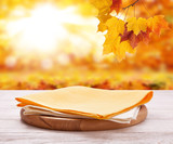 Pizza board with towel on wooden desk. Autumn background. Top view mock up. Selective focus. - 228669550
