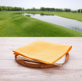 Pizza board, with tablecloth on wooden table and summer background. Top view mockup - 228669555