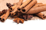 Cinnamon sticks and star anise isolated on white background - 228687398