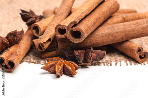 Leinwandbild Motiv Cinnamon sticks and star anise isolated on white background